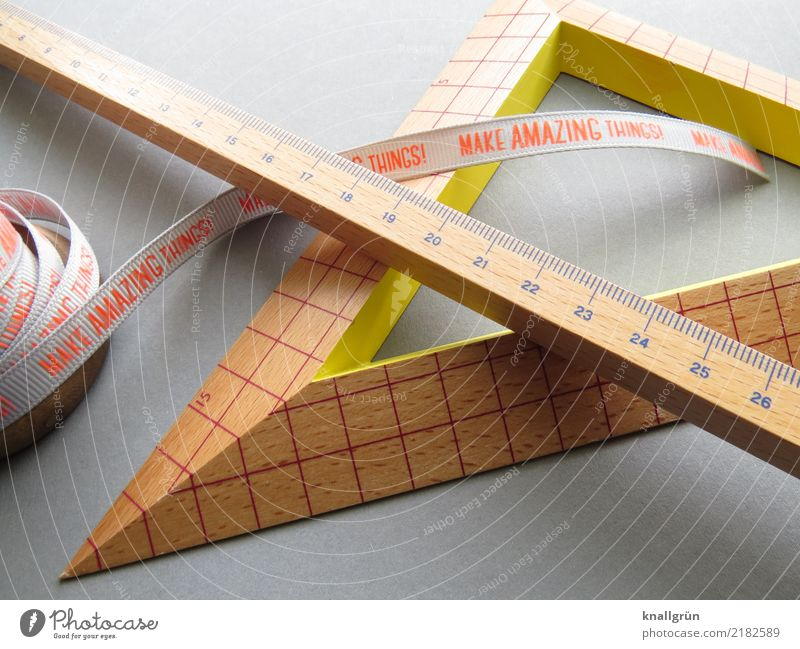 MAKE AMAZING THINGS! Ruler Protractor triangle Characters Communicate Sharp-edged Brown Yellow Gray Orange Emotions Determination Curiosity Interest Design