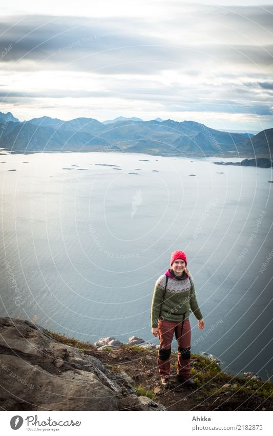 Young woman standing on a cliff above Lofoten Vacation & Travel Adventure Far-off places Freedom Hiking Youth (Young adults) Landscape Fjord Ocean Lofotes