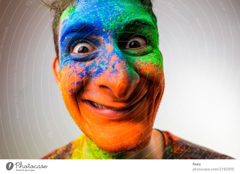 crackers Multicoloured Laughter Smiling Crazy Perspective Holi Kino Powder Man Young man Face Blue Yellow Green Orange Nose Large Looking into the camera