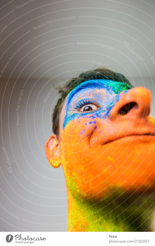 Colourful, painted face Multicoloured Laughter Smiling Crazy Perspective Holi Kino Powder Man Young man Face Blue Yellow Green Orange Nose Large