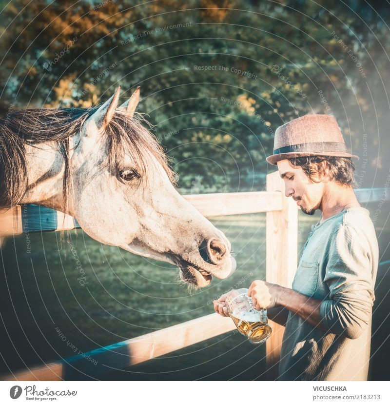 Beer for horses Lifestyle Human being Young man Youth (Young adults) Hand Nature Animal Horse Emotions Moody Joy Oktoberfest Humor Funny Colour photo