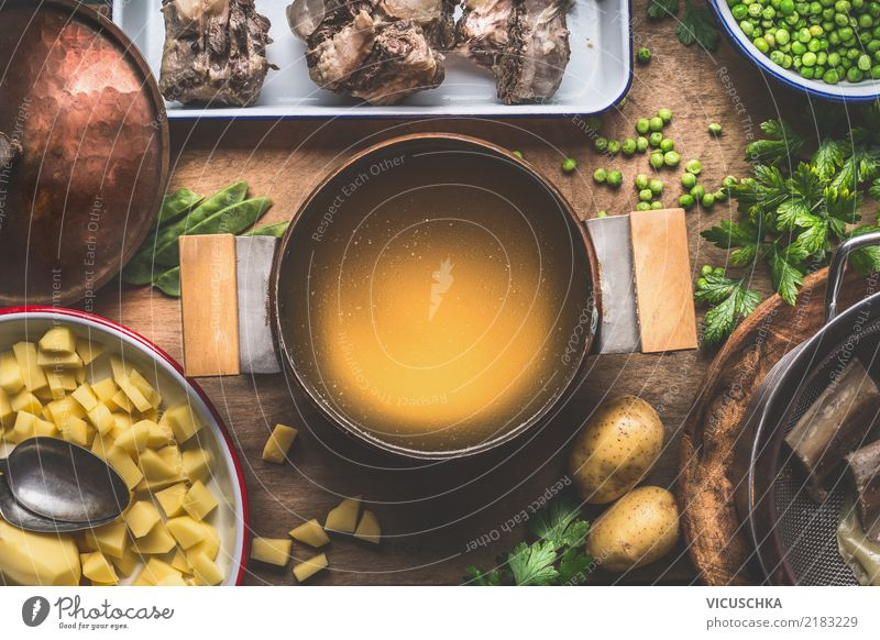 Pot with meat stock Food Meat Vegetable Soup Stew Herbs and spices Nutrition Lunch Dinner Organic produce Crockery Spoon Style Design Living or residing Table