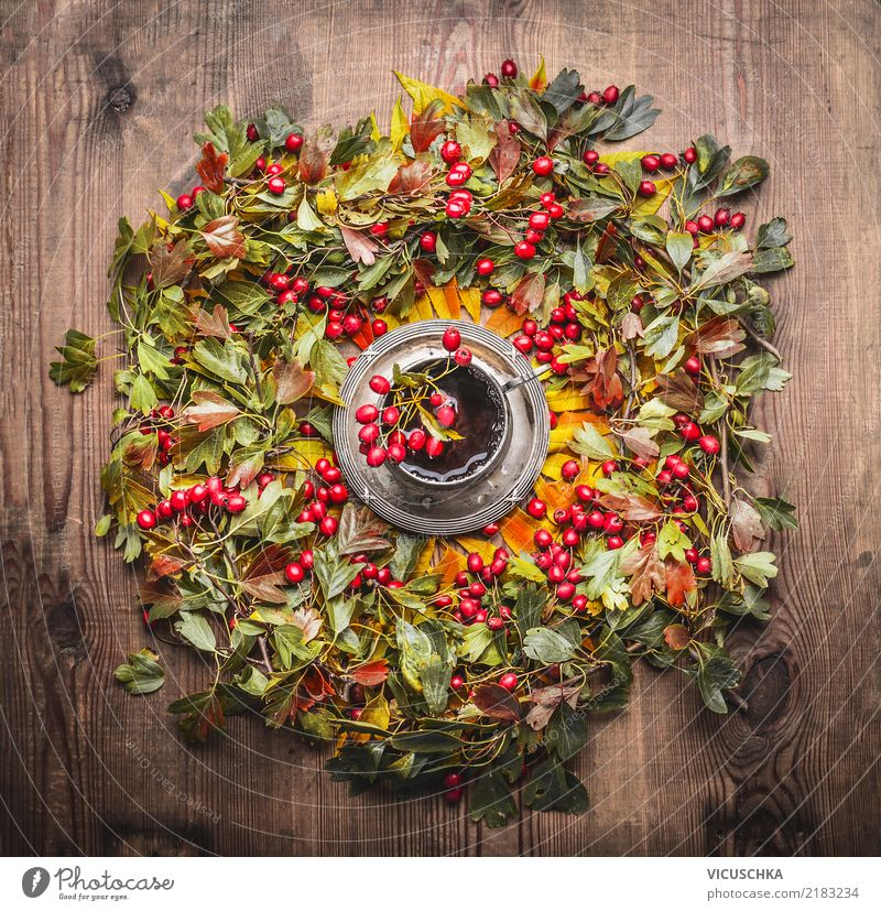 Wreath of autumn leaves and berries and cup of tea Food Beverage Hot drink Tea Cup Style Design Living or residing Table Thanksgiving Autumn Warmth Yellow