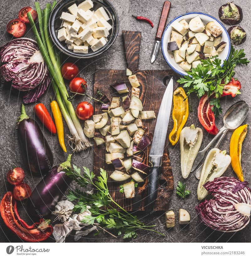 Kitchen table with vegetable ingredients, chopping board and knife Food Vegetable Herbs and spices Cooking oil Nutrition Lunch Dinner Organic produce
