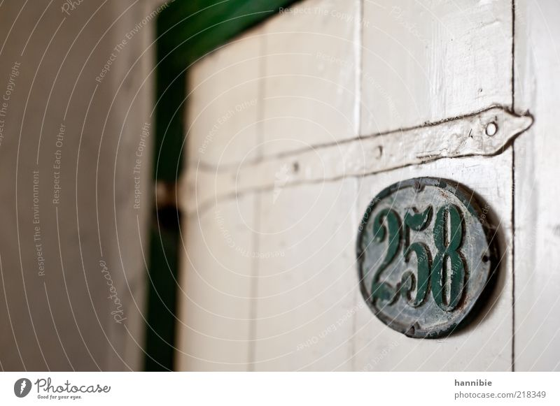 258 Door Wood Metal Old Dirty Green White Canceled Wooden door House number Dusty Forget Loneliness Old fashioned Varnished Colour photo Interior shot Deserted