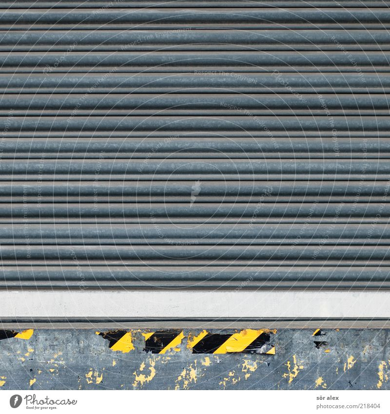 incoming goods Storage Gate Metal Yellow Black Silver Gray Tin Services Trade Logistics Loading ramp Warn Warning label Work and employment Warning sign Facade