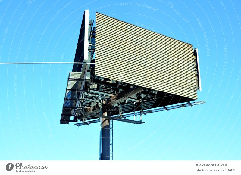 In all directions. Signs and labeling Advertising Display Colour photo Deserted Copy Space left Copy Space top Neutral Background Day Sunlight Billboard