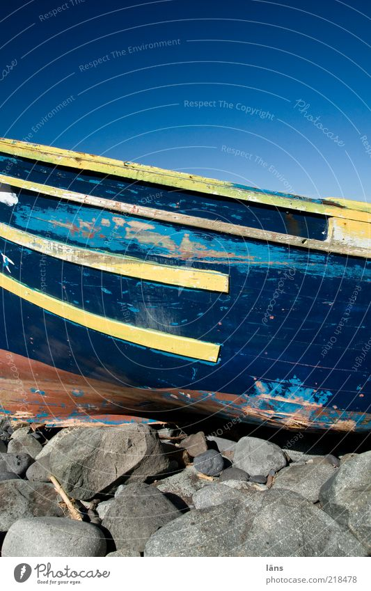 wreck Sky Cloudless sky Beautiful weather Coast Navigation Fishing boat Stone Wood Old Authentic Blue Yellow Decline Change Varnish Paintwork Broken Stranded