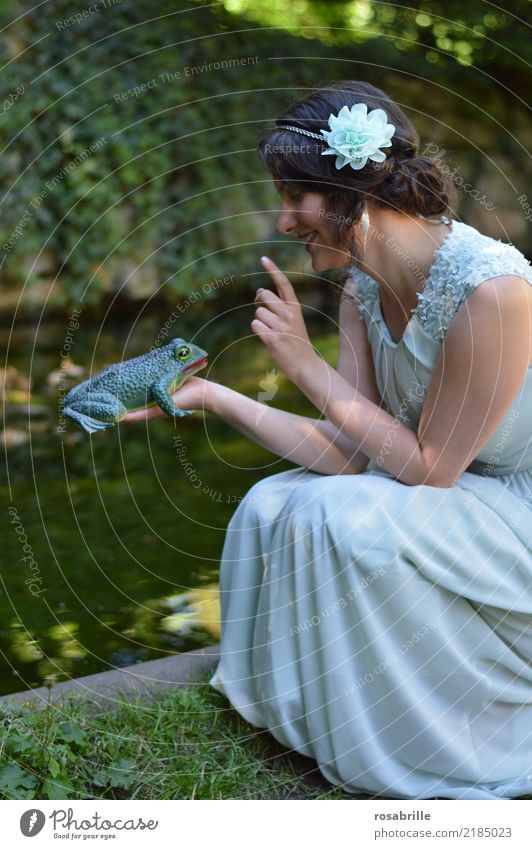 ... kiss a frog ?          - young brunette woman in evening dress looks at a frog she holds in her hand Feminine Young woman Princess Stage play Frog Prince