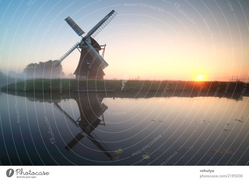 charming windmill by lake at misty sunrise Sky Nature Blue Summer Sun Landscape Architecture Building Lake Horizon Fog Vantage point Beautiful weather River