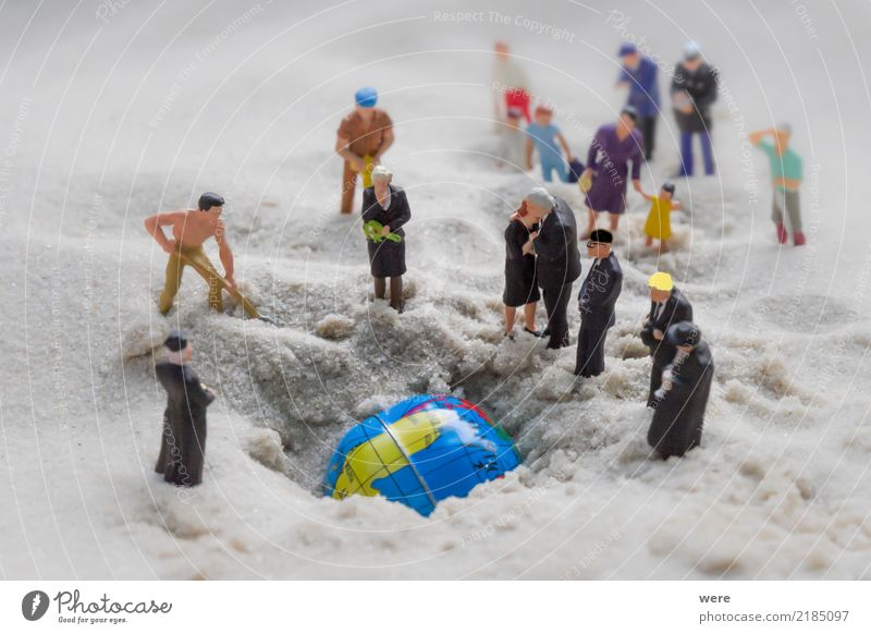A group of people bury the earth that died. Crowd of people Earth Climate Climate change Globe Grief Death Fear of the future Stupid Ignorant Discordant