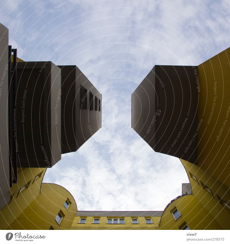 Sky House (Residential Structure) Clouds Yellow Dark Wall (building) Above Window Gray Wall (barrier) Architecture High-rise Facade Perspective Modern