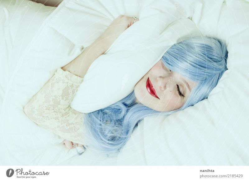 Young woman smiling in dreams and hugging a pillow Human being Youth (Young adults) Blue Beautiful White Joy 18 - 30 years Face Adults Lifestyle Feminine