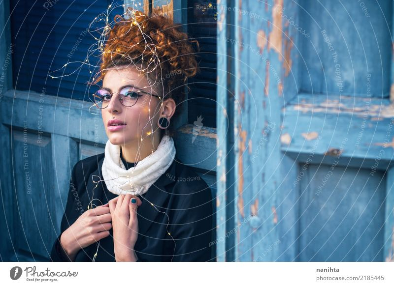 Young redhead woman with christmas lights Human being Youth (Young adults) Young woman Blue Christmas & Advent Beautiful White Window 18 - 30 years Black Adults