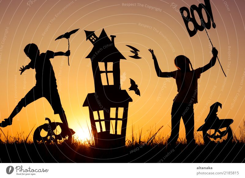 Happy brother and sister playing outdoors at the sunset time. Child Human being Hand House (Residential Structure) Joy Black Lifestyle Autumn Boy (child)