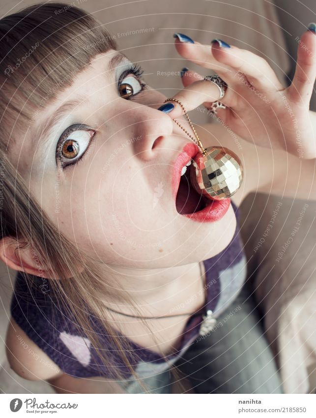 Young woman eating a disco ball Human being Youth (Young adults) Beautiful 18 - 30 years Face Adults Eating Lifestyle Funny Feminine Style Feasts & Celebrations