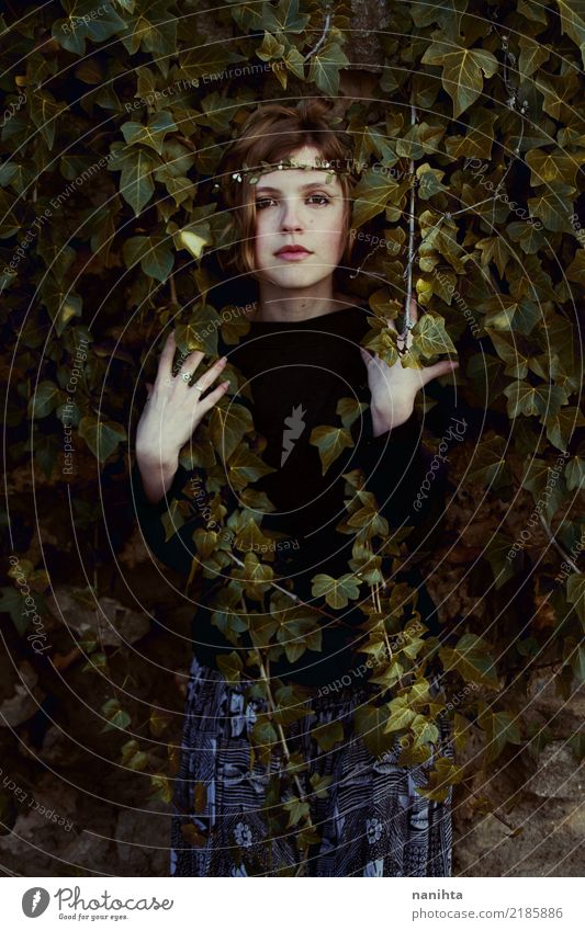 Young woman covered by a ivy Human being Nature Youth (Young adults) Plant Leaf Dark 18 - 30 years Adults Environment Autumn Spring Natural Feminine Art