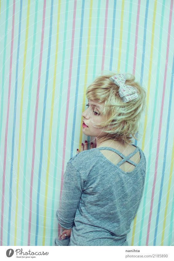 Young blonde woman posing in a striped background Lifestyle Style Beautiful Human being Feminine Young woman Youth (Young adults) 1 18 - 30 years Adults Fashion