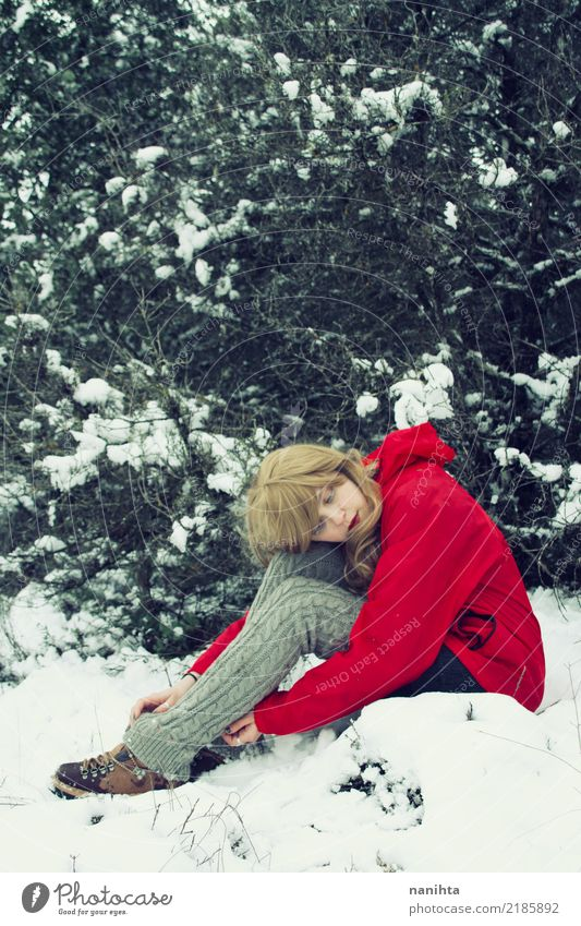 Young blonde woman lost in a snowy forest Human being Nature Vacation & Travel Youth (Young adults) Young woman Red Far-off places Winter Forest 18 - 30 years