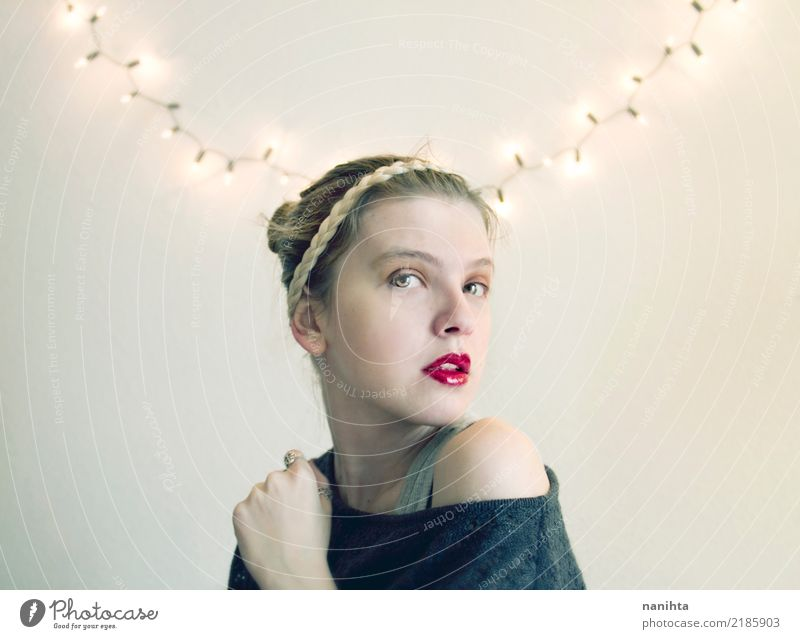 Young blonde woman and fairy lights at home Elegant Style Beautiful Face Lipstick Christmas & Advent New Year's Eve Human being Feminine Young woman