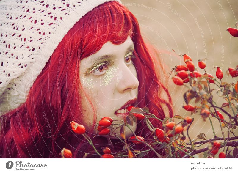 Young redhead woman biting a berry Fruit Berries Eating Organic produce Lifestyle Style Beautiful Skin Face Make-up Human being Feminine Young woman