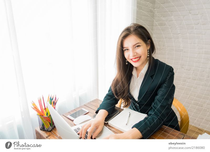 A business woman working on the laptop Lifestyle Design Beautiful Desk Work and employment Profession Office Business Telephone Computer Notebook Technology