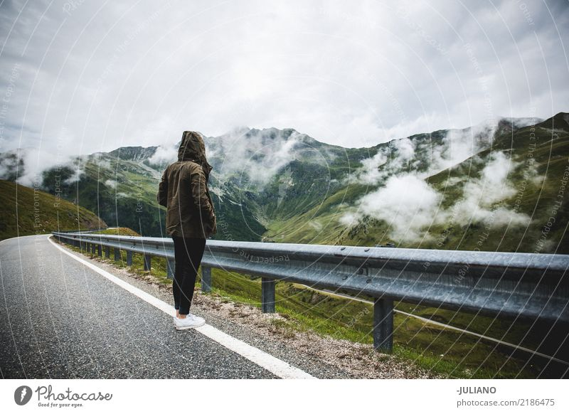 Girl is standing on a road right trough the alps Human being Nature Vacation & Travel Youth (Young adults) Young woman Beautiful Landscape Joy Far-off places