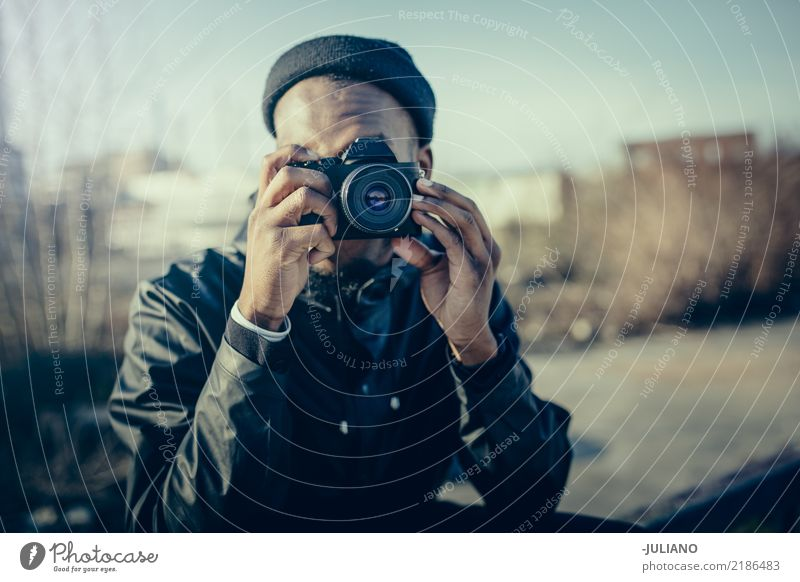 Young man is taking picture with camera Lifestyle Leisure and hobbies Photography Vacation & Travel Trip Adventure City trip Human being Masculine