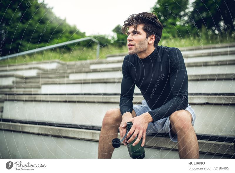 Young sports man sitting at staircase with water bottle break Drinking water Lifestyle Joy Body Healthy Healthy Eating Health care Athletic Muscular Fitness