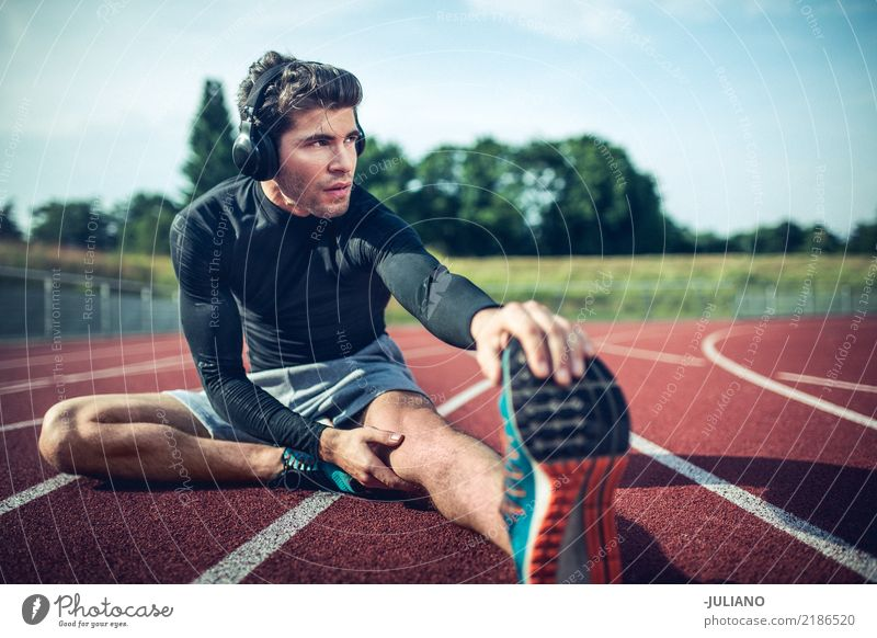 Young runner is stretching before workout Nutrition Lifestyle Healthy Athletic Fitness Leisure and hobbies Sports Sports Training Track and Field Sportsperson