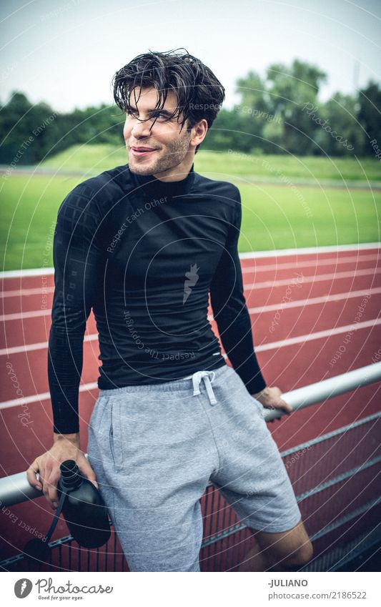 sports man is taking brake at running track Human being Nature Youth (Young adults) Young man 18 - 30 years Adults Lifestyle Sports Leisure and hobbies