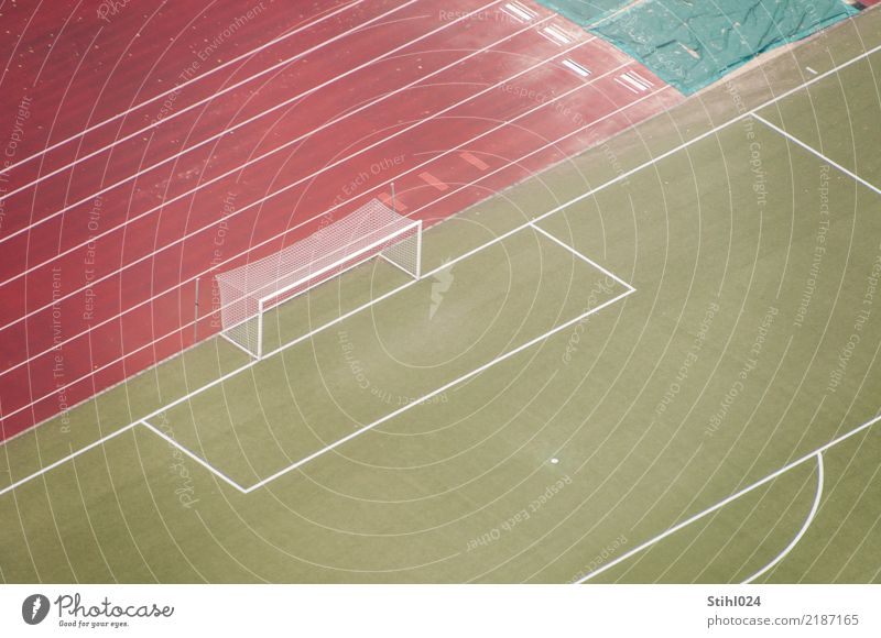 a lot of space on the square Leisure and hobbies Ball sports Soccer Sporting Complex Football pitch Sports Far-off places Green Red Boredom Loneliness Deserted