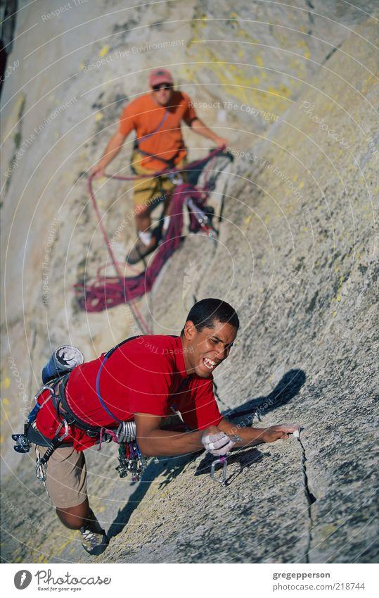Rock climbing team. Human being Man Adults Sports Friendship Tall Adventure Rope Climbing Trust Risk Athletic Balance Teamwork Attempt Vertical