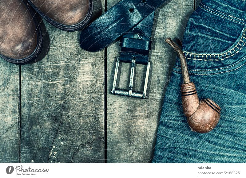 worn blue jeans and brown shoes Style Design Fashion Clothing Jeans Leather Footwear Boots Wood Old Hip & trendy Above Retro Blue Brown Black pocket pipe Denim