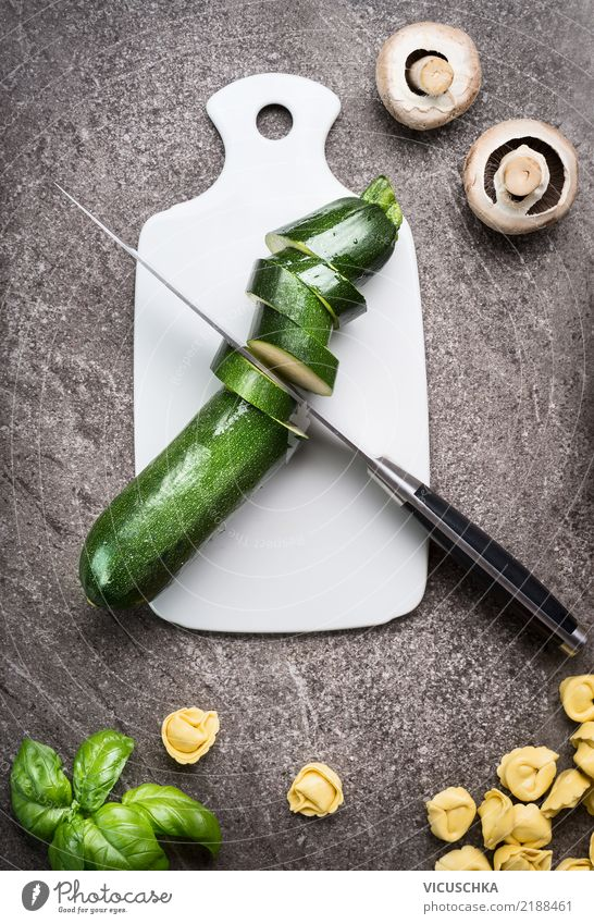 Green cut zucchini on chopping board Food Vegetable Herbs and spices Nutrition Lunch Organic produce Vegetarian diet Diet Crockery Knives Style Design