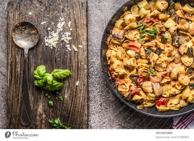 Tortellini pan with vegetable sauce and spoon Food Vegetable Dough Baked goods Nutrition Lunch Dinner Banquet Organic produce Diet Italian Food Crockery Pan