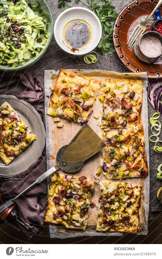 Tarte flambée and salad Food Vegetable Lettuce Salad Dough Baked goods Bread Herbs and spices Nutrition Lunch Organic produce Crockery Plate Bowl Fork Spoon