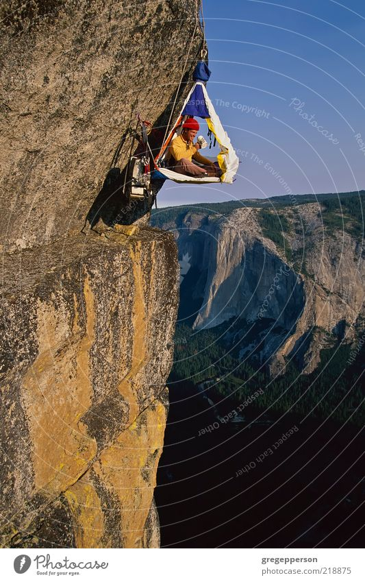 Rock climber in his shelter. Human being Adults Sports Power Tall Adventure Rope Success Climbing 18 - 30 years Athletic Brave Risk Balance Vertical Attempt