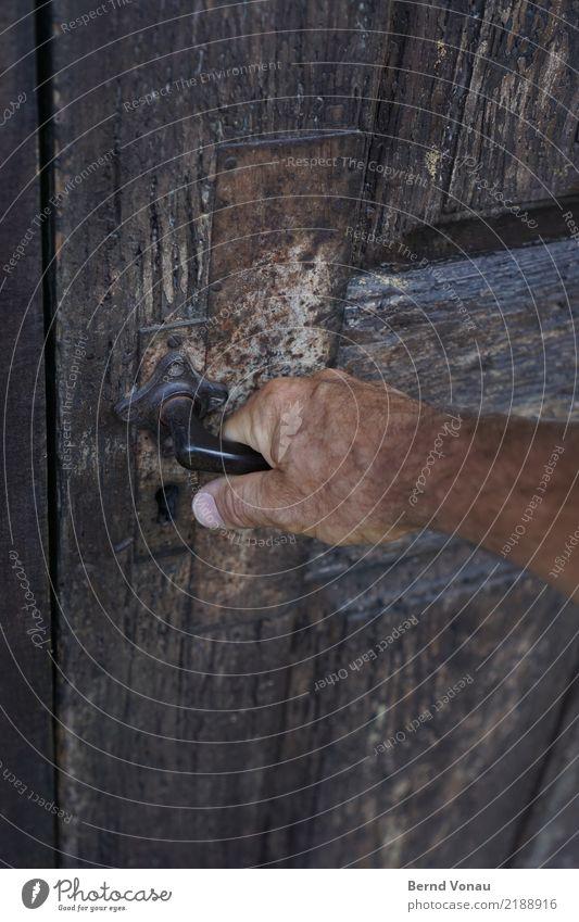 access Masculine Skin Hand 1 Human being House (Residential Structure) Door Curiosity Wooden door Old Door handle Grasp Undo Weathered Gray Brown Access Barn