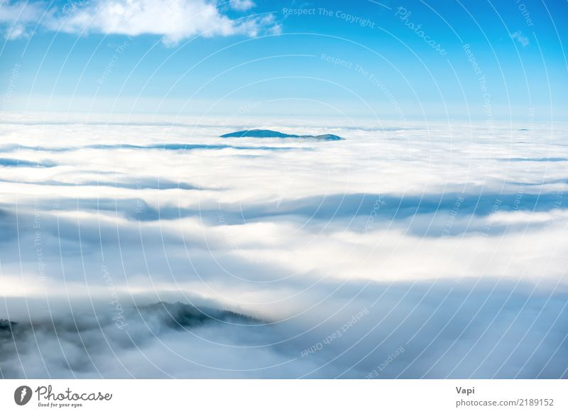 Green mountain peak in the clouds Sky Nature Vacation & Travel Blue Summer White Landscape Ocean Clouds Mountain Yellow Natural Freedom Rock Horizon