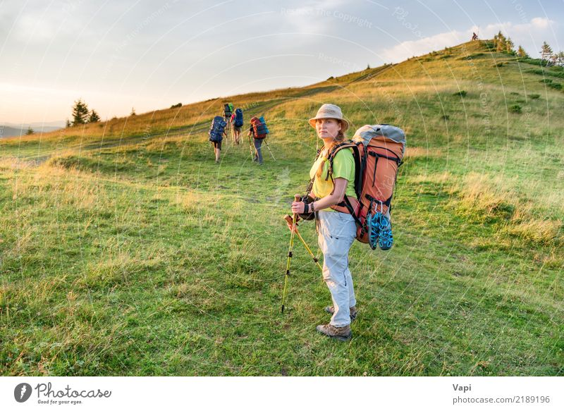 Young woman hiking with friends Lifestyle Wellness Leisure and hobbies Vacation & Travel Tourism Trip Adventure Freedom Camping Summer Summer vacation Mountain