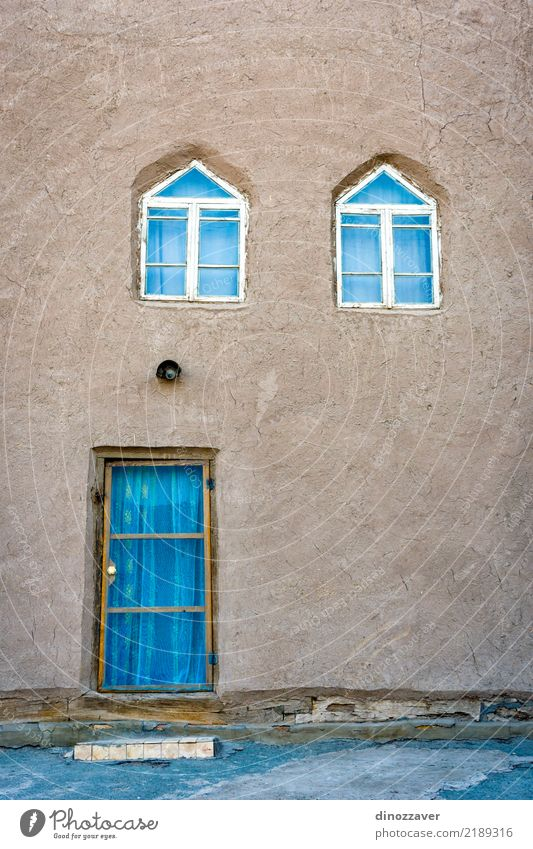 Mud house in Khiva downtown Design Vacation & Travel Tourism Decoration Art Culture Church Building Architecture Facade Wood Ornament Old Historic Colour