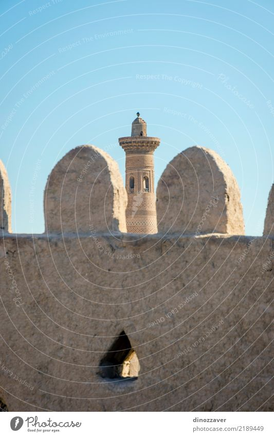 Old city wall and minaret, Khiva, Uzbekistan Style Design Decoration Sand Town Old town Skyline Architecture Ornament Religion and faith Tradition Islam Moslem