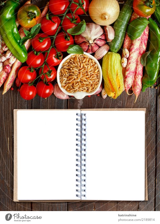Uncooked kamut grain with vegetables on wood Green White Natural Wood Brown Bright Table Paper Vegetable Harvest Bowl Diet Vegetarian diet Tomato