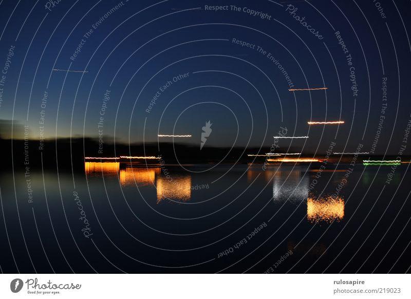 moving lights Calm Summer Ocean Island Nature Water Cloudless sky Night sky Horizon Coast Bay Baltic Sea Als Dyvig Harbour Blue Black Colour photo Multicoloured
