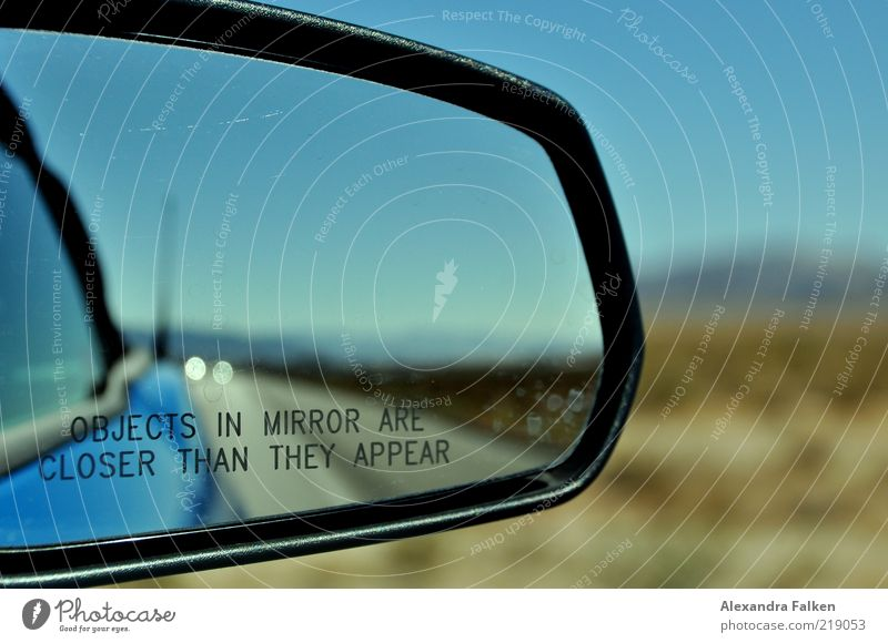 Objects in mirror... Transport Means of transport Traffic infrastructure Road traffic Motoring Street Vehicle Car Blue Rear view mirror Travel photography