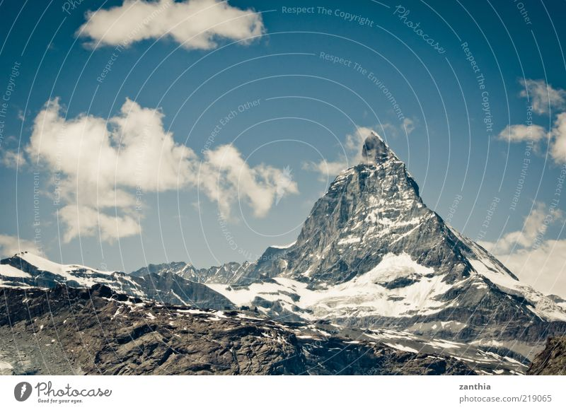 matte horn Nature Landscape Sky Clouds Summer Climate Climate change Beautiful weather Snow Alps Mountain Peak Snowcapped peak Old Firm Gigantic Large Blue Gray