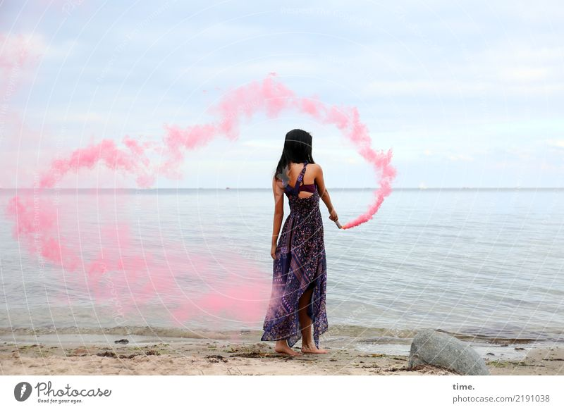 pink steam (II) Feminine Woman Adults 1 Human being Sky Coast Beach Baltic Sea Dress Black-haired Long-haired colour torch Stone Movement To hold on Stand