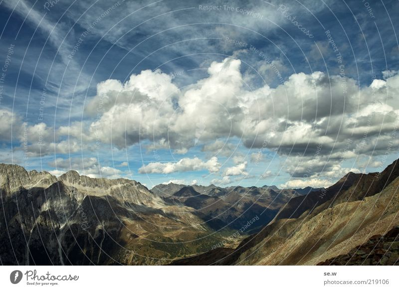 Sky Blue Summer Clouds Loneliness Far-off places Mountain Freedom Brown Horizon Authentic Alps Infinity Peak Beautiful weather