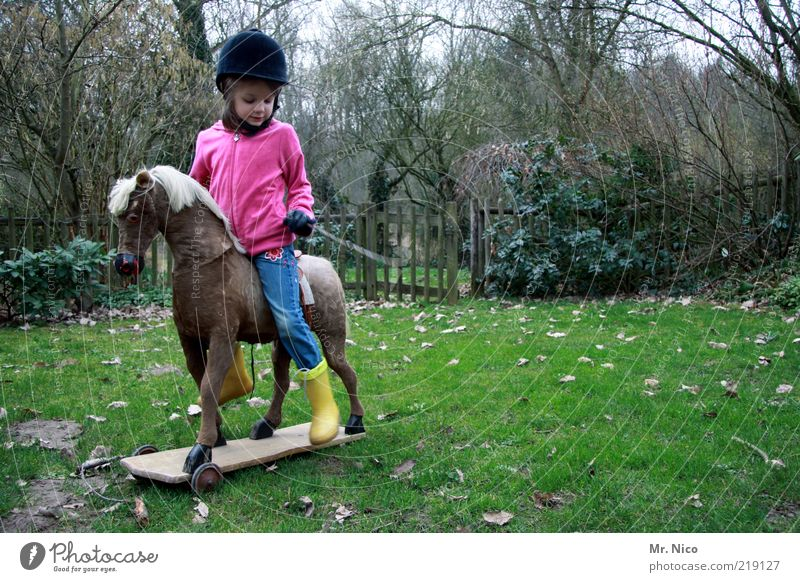 Galopper of the year Leisure and hobbies Playing Ride Garden Equestrian sports Girl Infancy Nature Autumn Rubber boots Helmet Horse Yellow Green Pink Joy